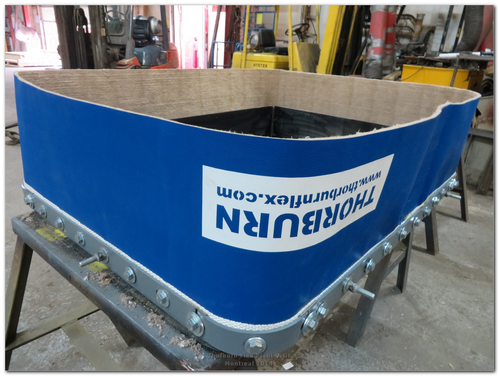 Fabric expansion joint in assembly stage. Flexible membrane made of composite material:PTFE (Teflon) coated fiberglass with laminated PTFE continuous film and 1/2″of fiberglass insulation with a design temperature of 1000°F